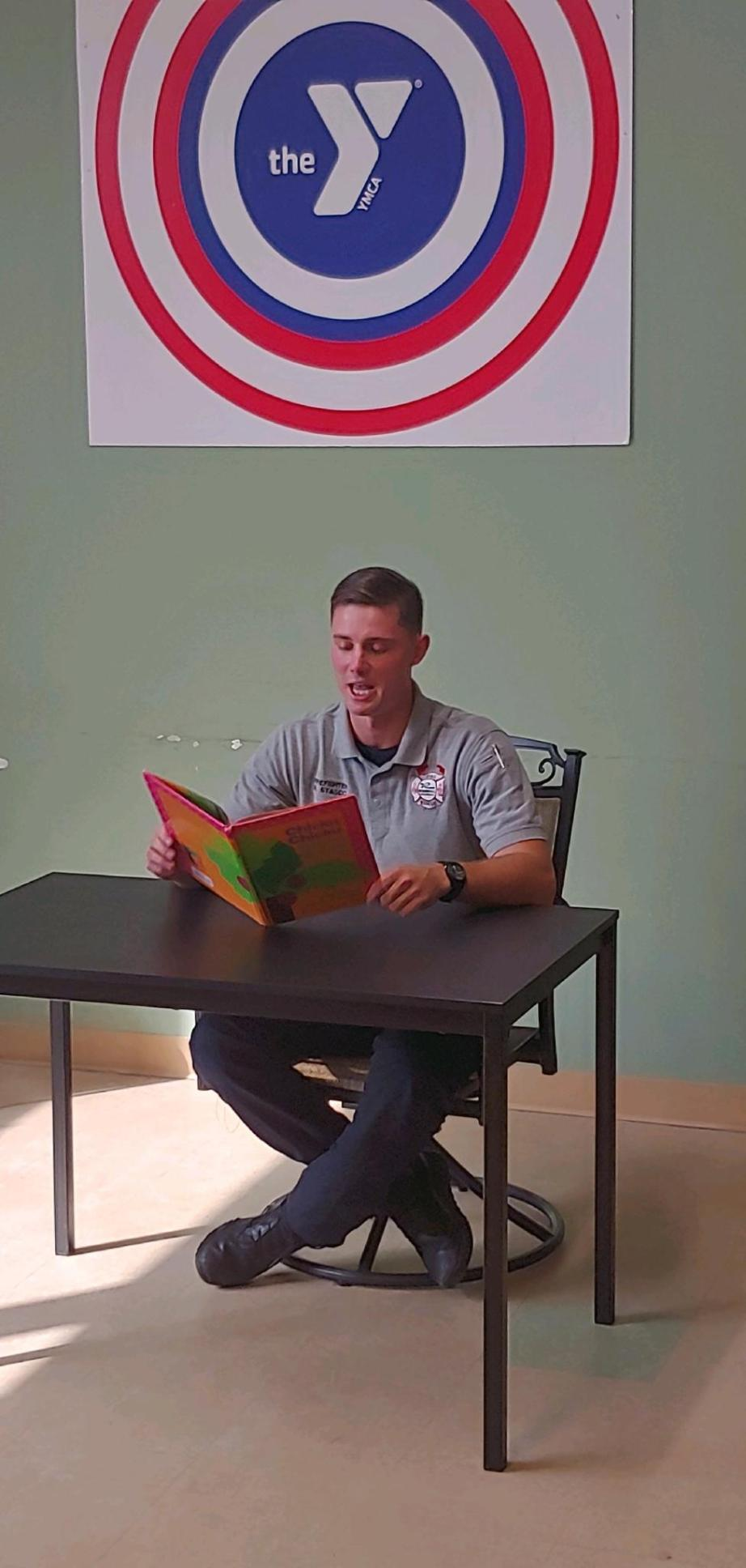 A man reads from a children's book