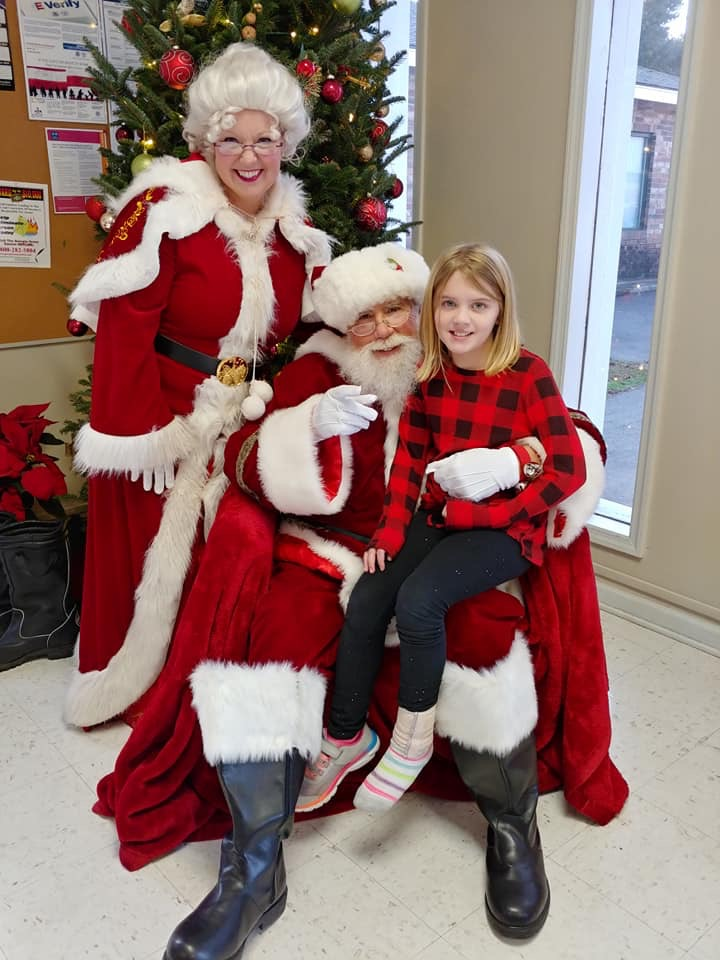 Santa and Mrs. Claus with a child