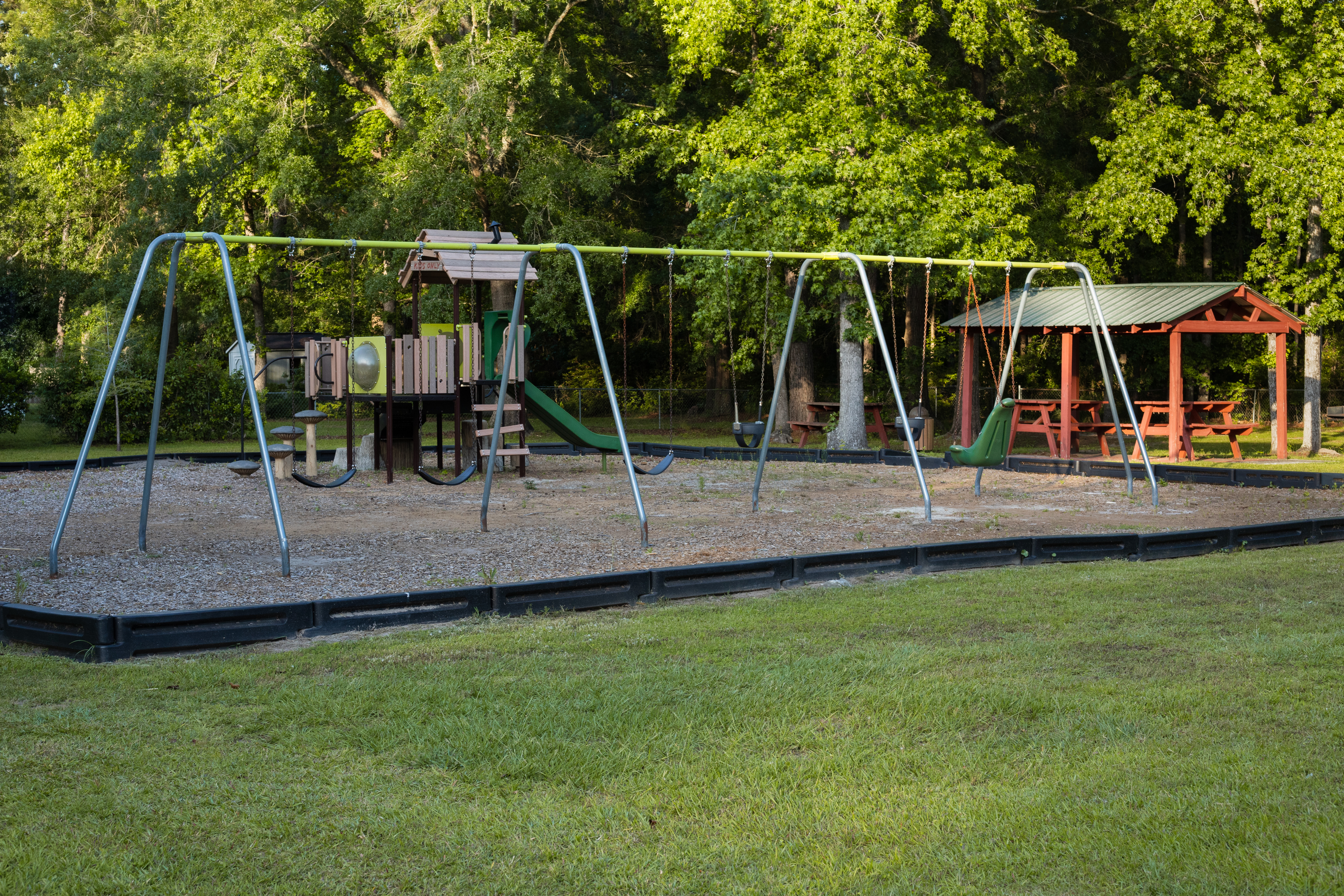 Richmond Heights Park swing set and pavilion